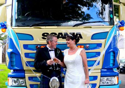 The new Mr & Mrs Alan Gillie in front of their chosen mode of transport, an Oakley Supremacy Scania horsebox.